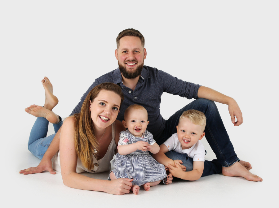 Relaxed family portrait with young children
